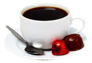 a cup of coffee with chocolates